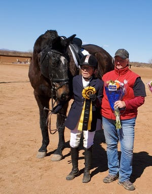Gail Feeley is pictured with her horse, Tantrioso, and trainer Denise Maggard on Sunday, Feb. 21, 2021.