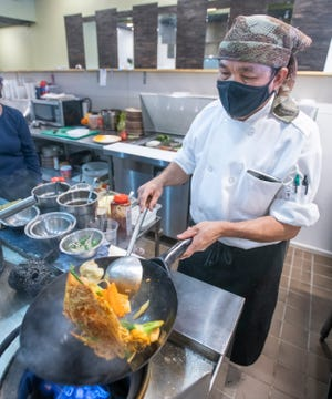 Owner and chef Supoj (Paul) Polngam prepares an order of pad Thai at his Thai Rice Restaurant at 7175 North Davis Highway in Pensacola on Tuesday.