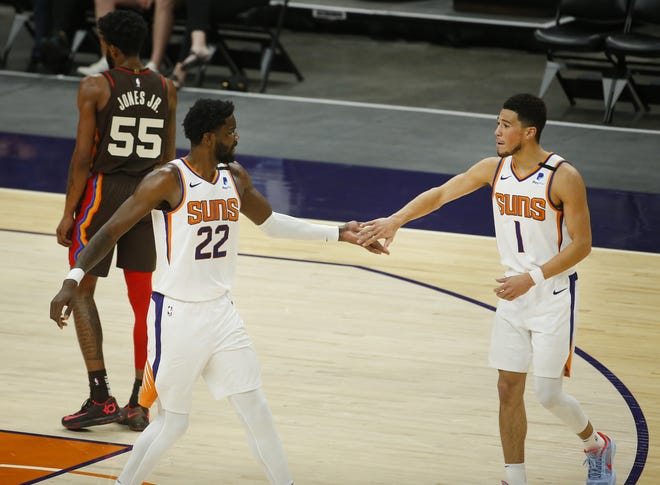 Feb. 22, 2021; Phoenix, Arizona, USA; Suns' Devin Booker (1) and Deandre Ayton (22) celebrate a basket and foul for Ayton during the second half against the Trailblazers at the Phoenix Suns Arena. Mandatory Credit: Patrick Breen-Arizona Republic