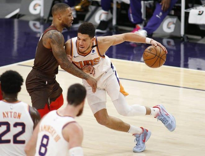 Devin Booker anotó 34 puntos en la victoria de los Suns.