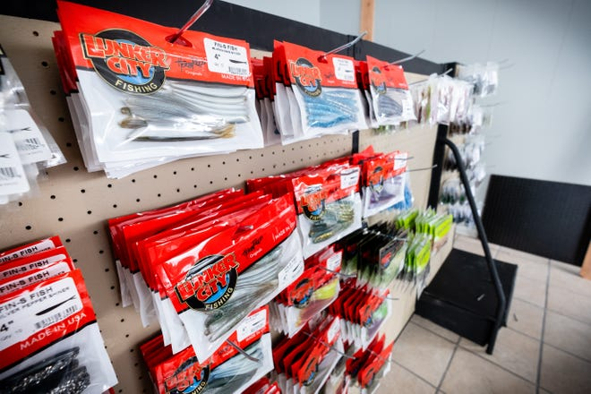 Merchandise hangs on the shelf at Hook One Bait & Tackle in Marine City. Pete Patsalis, who owns the shop, is aiming for a mid-March opening.