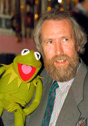 "Jim Henson, creator of the Muppets, poses with Kermit the Frog in 1988. ""The Muppet Show"" is now available on Disney+, but some episodes have a content disclaimer."