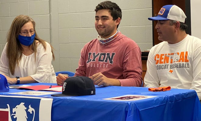 San Angelo Central High School first baseman Ryan Ramon signed a scholarship with Lyon College in Batesville, Arkansas, on Monday, Feb 22, 2021 as his parents looked on.