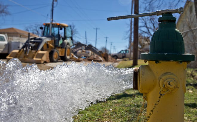 Workers with the city of San Angelo repair a water main break near the intersection of Howard St. and North St. on Monday, Feb. 22, 2021.