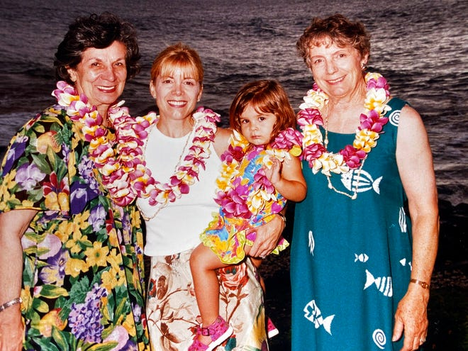 In this September 1999 photo provided by Sophia Eppolito, she poses for a photo while on vacation with from left, Julie Eppolito, Cindy Eppolito and Louise Delfino on the coast of Maui, Hawaii during a family vacation. In a wrenching coincidence that seemed made for 2020, journalist Sophia Eppolito lost both her grandmothers in four months last year. (Jim Eppolito via AP)
