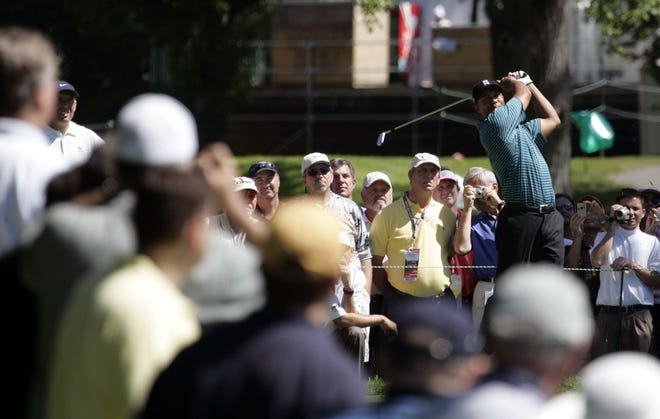 Tiger Woods tees off on the 12th hole during the second practice round of the U.S. Open Championship at Winged Foot Golf Club in Mamaroneck June 13, 2006.