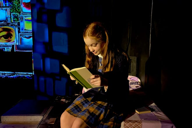 """The smart, witty and extraordinarily precocious Matilda Wormwood (Emily Calvert) quietly reading in """"Roald Dahl's Matilda the Musical."""" The musical opens this weekend at the Wichita Theatre at 7 p.m. Friday; 2 p.m. and 7 p.m. Saturday and 2 p.m. Sunday. The show runs through March 13."""