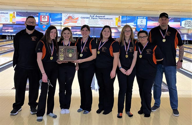 The New Lexington girls bowlers earned their first state berth in program history by winning the Division II district title on Monday at Shawnee Lanes. Team members and coach are (left to right): Coach Jonathan Evans, Alexis McCord, Jaslan Fortner, Jazz Cozad, Courtney Jones, Natasha Bailey, Samantha Fiore and Coach Timothy A. Newsome Sr.