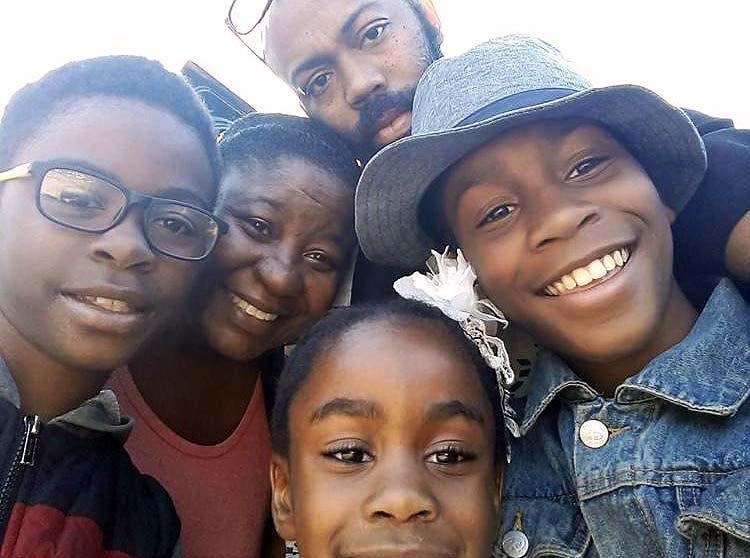 Tia Ferguson, 40, is pictured here with her husband and their three children. If they receive a third round of stimulus checks, they are both using it toward opening their own businesses.