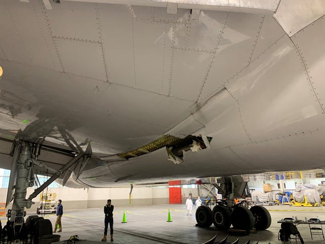 This Feb. 22 photo shows damage to the wing and body fairing of a United Airlines Boeing 777-200 following an engine failure incident.