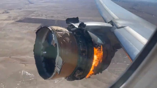 """In this image taken from video, the engine of United Airlines Flight 328 is on fire after after experiencing """"a right-engine failure"""" shortly after takeoff from Denver International Airport, Feb. 20, 2021, in Denver, Colo. The Boeing 777 landed safely and none of the passengers or crew onboard were hurt."""