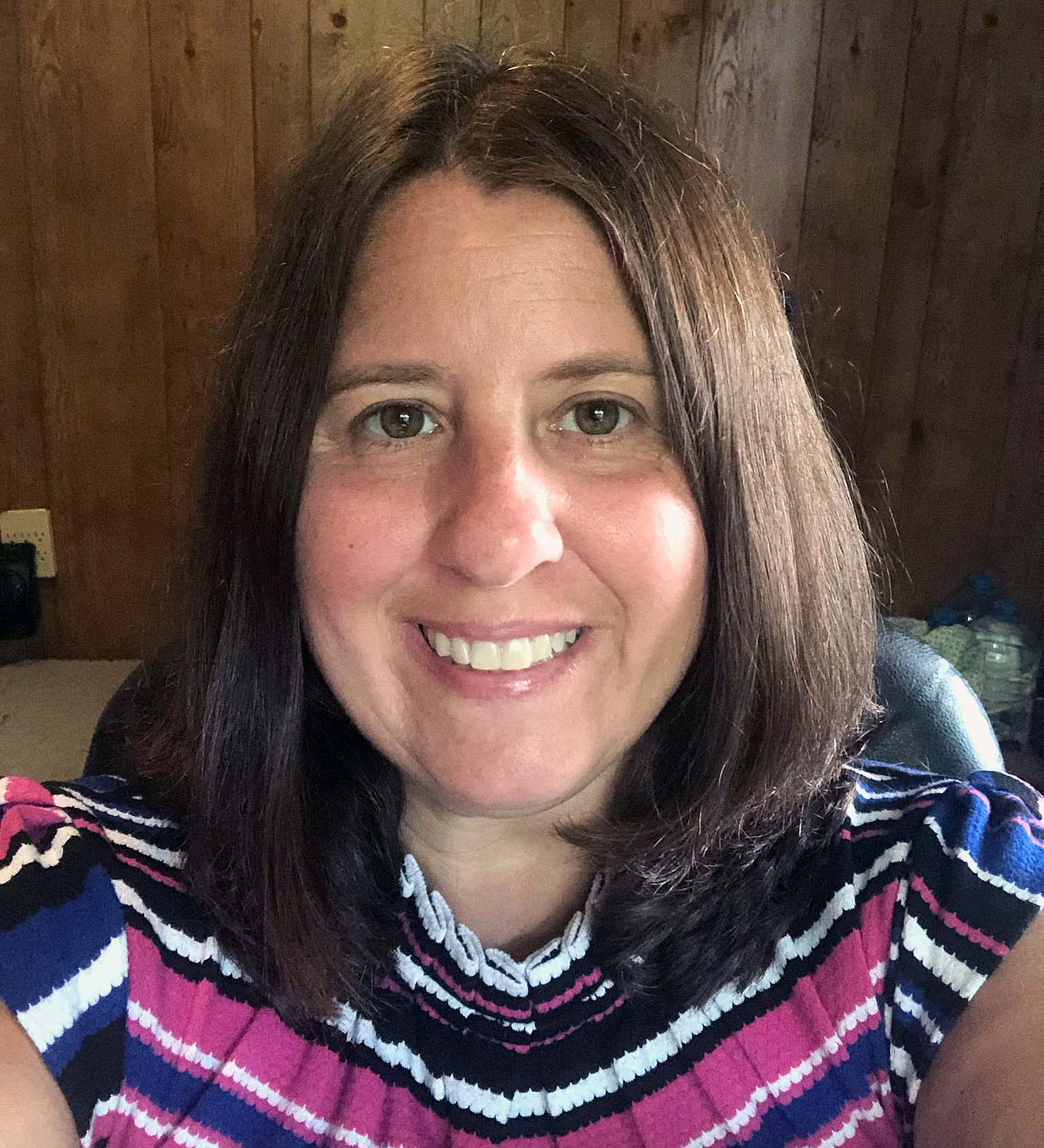 Katie Krupp, 42, poses for a selfie. The reading teacher was laid off when schools shut down during the initial outbreak of the pandemic and has decided to go back to school.