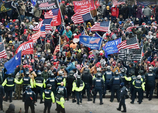 Trump supporters clash with police and security forces at the U.S. Capitol on Jan. 6, 2021.