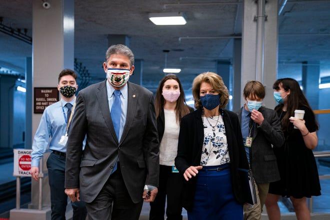 Sen. Joe Manchin, D-W.V., and Sen. Lisa Murkowski, R-Alaska, speak as they arrive to vote in the U.S. Capitol on Tuesday.