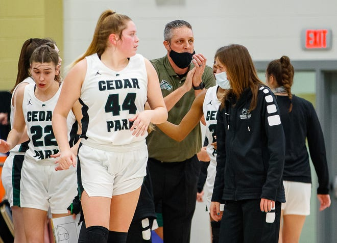 Cedar Park Timberwolves head coach Donny Ott cheers his team during its second-round playoff win over San Antonio Highlands on Monday. The Timberwolves face New Braunfels Canyon in a third-round matchup Wednesday.