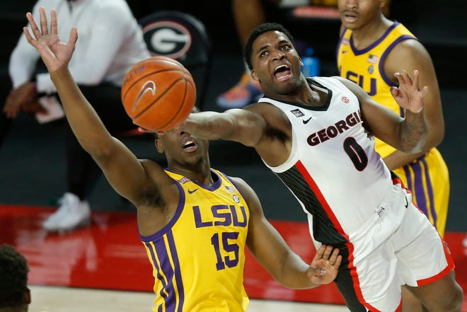 Georgia's K.D. Johnson (0) takes a shot while being defended by LSU guard Aundre Hyatt (15) during an NCAA basketball game between Georgia and LSU in Athens, Ga., on Tuesday, Feb 23, 2021. (Photo/Joshua L. Jones, Athens Banner-Herald)