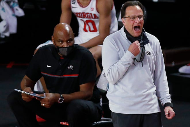 Georgia staff member Michael Curry, a former Georgia Southern player and NBA coach, and Georgia coach Tom Crean react during the team's basketball game against Kentucky on Wednesday, Jan. 20, 2021, in Athens, Ga.