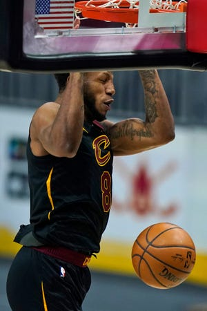 Cavaliers forward Lamar Stevens dunks during the Cavs' 112-111 win over the Atlanta Hawks Tuesday night. Stevens' dunk in the final seconds secured the victory for the Cavs. [Tony Dejak/Associated Press]