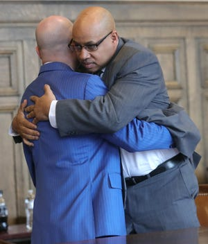 Former Summit County Sheriff Deputy Antonio Williamson hugs his defense attorney Ian Friedman after a jury returned a not guilty verdict in March 2020. (Phil Masturzo/Akron Beacon Journal)
