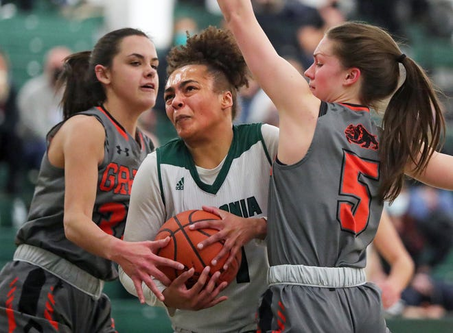 Nordonia's Madison Cluse, center, looks to score between Green's Alyssa Ziehler, left, and Mallory Oddo, right, during a game this winter. Cluse was named special mention All-Ohio by the Ohio Prep Sportswriters Association.
