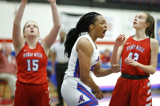 Moore High (Oklahoma) forward Aaliyah Moore celebrates during a game last month. A Texas signee, Moore was named a McDonald's All-American on Tuesday.
