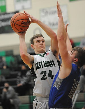 West Branch's Andrew Coffee puts up a shot over Hubbard's Kobe Krisuk in an OHSAA Division II tournament game Tuesday, February 23, 2021 at the West Branch Field House.