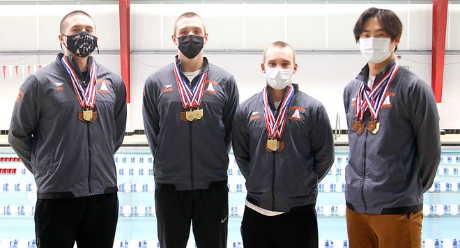Ashland's state swimming qualifiers Seth Will, Rylan McDaniel, Bailey Parsons and Daniel Cho pose for a picture before practice on Tuesday.