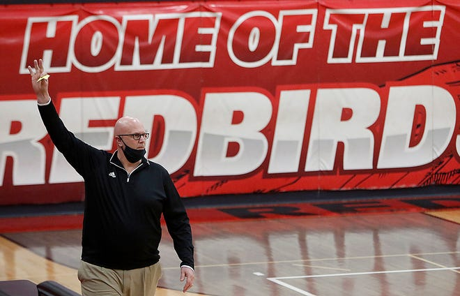 Loudonville's Kelly Seboe gives instructions from the bench during a game earlier this season. Seboe has decided to step down as head coach of the Redbirds.
