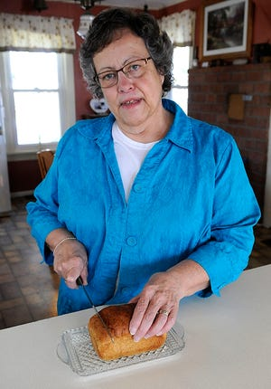 Martha Ramseyer slices her whole loaf bread recipe. TOM E. PUSKAR/TIMES-GAZETTE.COM