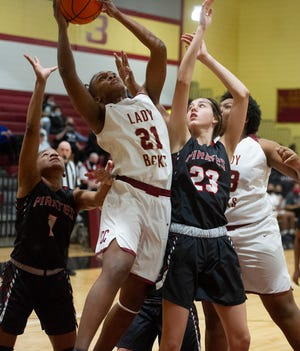 Jordyn Dorsey of Cross Creek, left, battles with Kyra Reynolds of Appling County, right, at the girls high school basketball game between Cross Creek and Appling County on February 23, 2021 in Augusta, Ga. [MIKE ADAMS FOR THE AUGUSTA CHRONICLE]