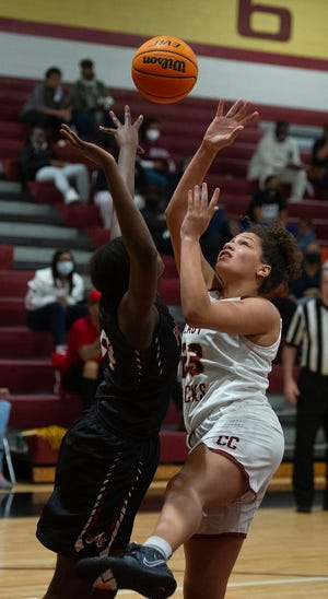 Erin Martin of Cross Creek, right, battles for rebound at the girls high school basketball game between Cross Creek and Appling County on February 23, 2021 in Augusta, Ga. [MIKE ADAMS FOR THE AUGUSTA CHRONICLE]