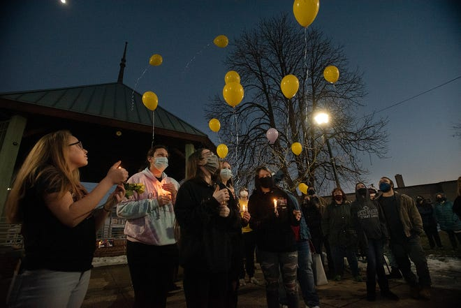 Friends of Ambridge Area High School student Jeffery Bright and 22-year-old Jasmine Cannady release balloons in their memory Tuesday evening at P.J. Caul Park in Ambridge. [Sally Maxson/For BCT]