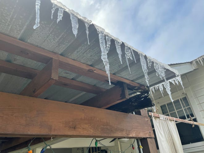 Icicles hang from the roof of a carport following a winter storm that affected much of Louisiana.