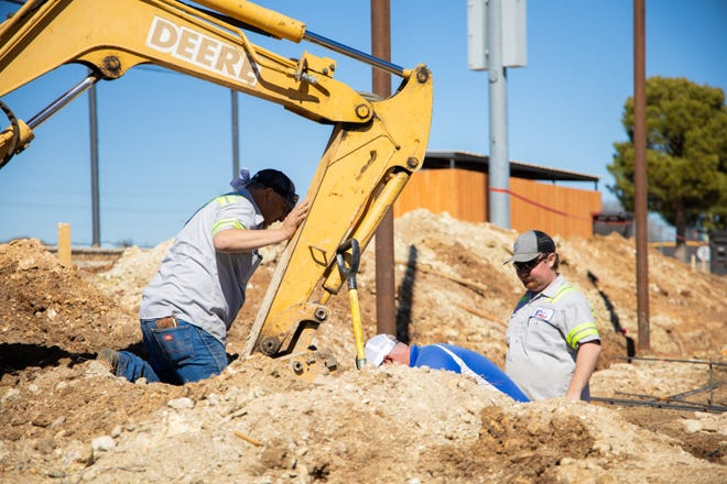 Work continues on the project to install sidewalks at the ballpark/softball complex in Early.