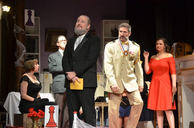 """Colonel Mustard (right foreground in uniform) takes a step forward to speak to Wadsworth (Jonathan Harvey) in a scene from Brownwood Lyric Theatre's production of """"Clue."""" A matinee performance of the comedy whodunnit will begin at 2:30 p.m. Friday at the Lyric Theatre downtown. Shows will continue at 7:30 p.m. Friday and Saturday, before the closing performance at 2:30 p.m. Sunday. Also pictured, from left to right, are Mrs. White (Valerie Nelson), Mr. Green (Paul Underwood), and Miss Scarlet (Cassia Rose). Tickets are available atwww.brownwoodlyrictheatre.com."""