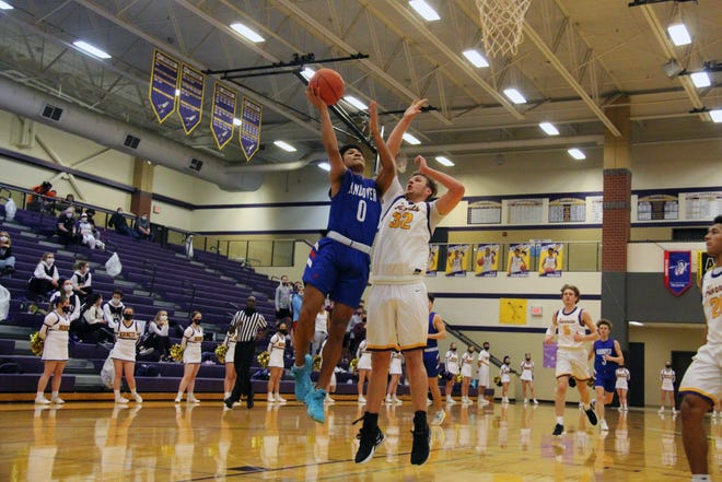 Andover senior, Isaiah Maikori (0) goes up for a layup against Valley Center's Noah Simmons (32) on Tuesday, Feb. 23 at Valley Center High School.