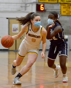 Nauset's Avery Burns, left, dribbles past Nantucket's Ciara Barnett during the first quarter Monday at Nauset Regional High School in North Eastham. Burns enters Friday's Cape & Island League Atlantic Tournament as one of the top shooters in Massachusetts. [Merrily Cassidy/Cape Cod Times]