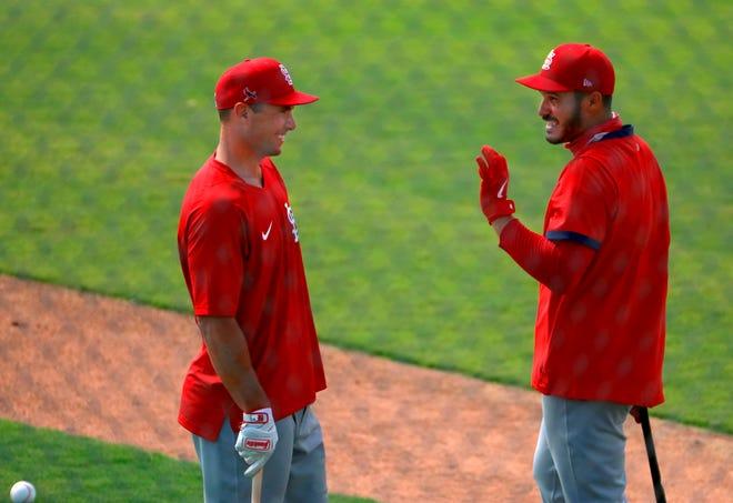 St. Louis Cardinals first baseman Paul Goldschmidt, left, and third baseman Nolan Arenado joke around between batting sessions during spring training Monday in Jupiter, Fla.