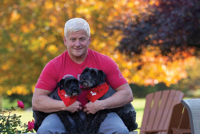Rustin Moore, dean of Ohio State University College of Veterinary Medicine, with dogs Teddy and Travis.