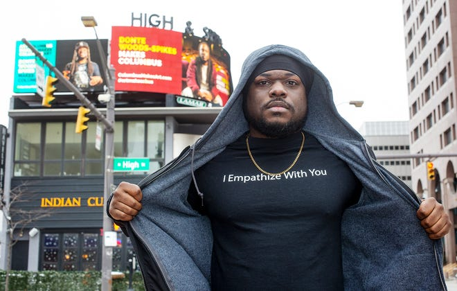 Local activist/filmmaker Donte Woods-Spikes on the corner of High and Spring streets Downtown where his billboard is shown.