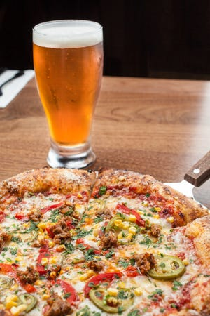 Spicy Yuma pizza and a Harvest Pale Ale, from Harvest Pizza