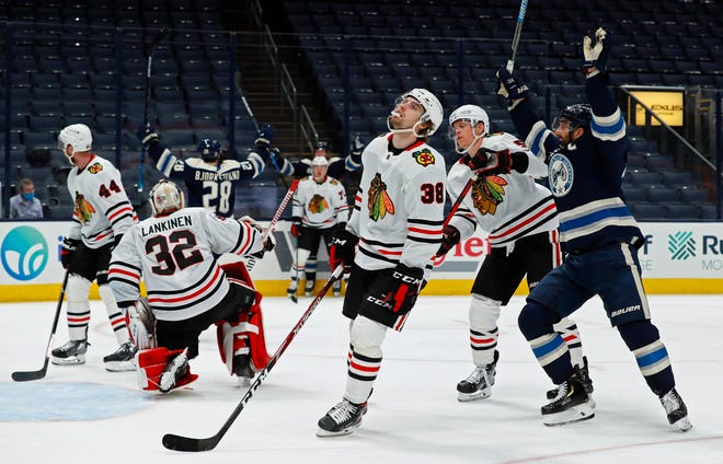 Columbus Blue Jackets right wing Oliver Bjorkstrand (28) celebrates his goal against Chicago Blackhawks goaltender Kevin Lankinen (32) during the third period of their NHL game at Nationwide Arena in Columbus, Ohio on February 23, 2021.