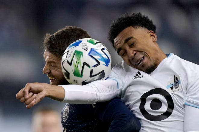 Minnesota United midfielder Marlon Hairsto (right) battles with Sporting Kansas City midfielder Ilie Sanchez, on Dec. 3, 2020. In the past three seasons with the Rapids, Houston Dynamo and Minnesota, Hairston's playing time has declined steadily and he hasn't had a goal since 2017 or an assist since 2018.