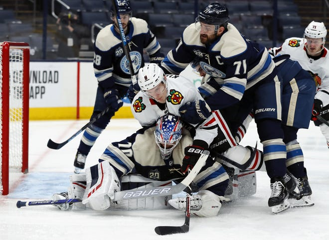 Nick Foligno (71), here helping in the defensive end on Tuesday against Chicago, moved up to center the top line and displayed some instant chemistry with linemates Oliver Bkjorkstrand (28) and Patrik Laine.