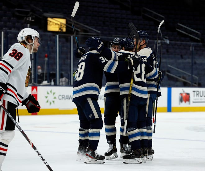 Columbus Blue Jackets right wing Oliver Bjorkstrand (28) celebrates his goal against Chicago Blackhawks during the third period of their NHL game at Nationwide Arena in Columbus, Ohio on February 23, 2021.
