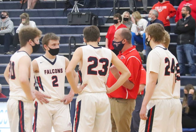 Fertile-Beltrami coach Neil Steffes talks to his team before tip-off against Crookston on Feb. 23. The Falcons are 10-2 this season after graduating eight seniors from last season's 25-win team.