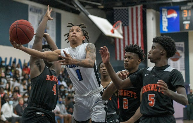 Wildwood's Nate Rembert (1) goes for a layup in the Class 1A-Region 4 championship game against Hawthorne Tuesday in Wildwood. [PAUL RYAN / CORRESPONDENT]