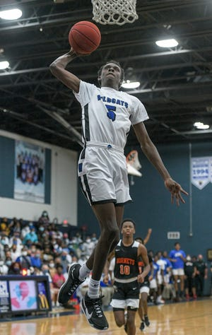 Wildwood's Nate Mikell (5) dunks during Tuesday's Class 1A-Region 4 championship game against Hawthorne at The Woodshed in Wildwood.  [PAUL RYAN / CORRESPONDENT]
