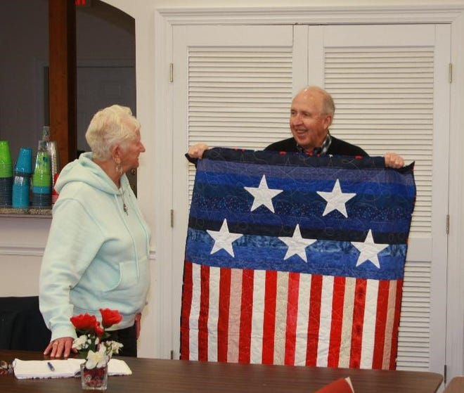 Destin snowbird Phyllis Hall of Michigan presents a quilt to Dr. Dewey Roberts, pastor of Cornerstone Presbyterian Church of Destin, as a show of appreciation for allowing the quilters to hold their meetings in his church. Officially, all snowbird activities have been cancelled this season because of the COVID virus. However, many snowbirds are in Destin, and through emails and the Group Facebook page, some are able to connect and take part in their favorite pursuits. Masks and social distancing are always advocated.