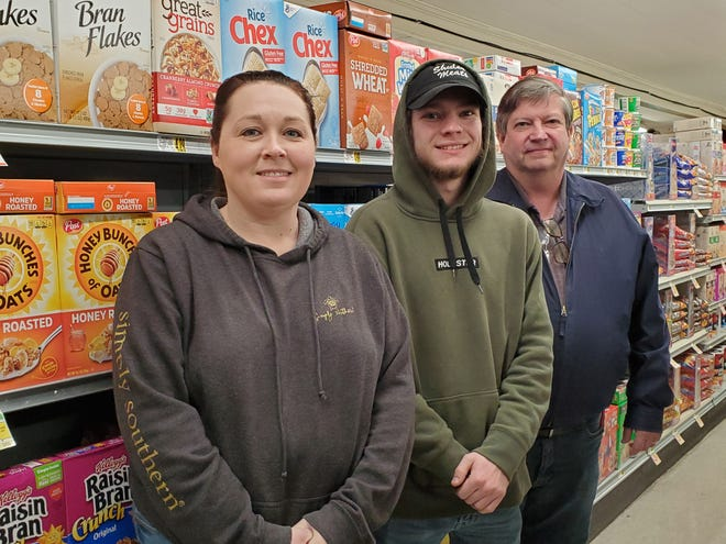 Alex Shuler (center) and his father, Wayne Shuler (right), owners of Shuler Meats have assumed operations of Cedar Lodge Market in Thomasville. Store manager Amy Loflin and other long-time employees will continue to work at the small, IGA grocery store as the Shulers complete improvements to the building and reset the store's stock.